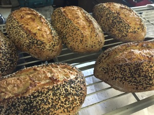 Seeded sourdough, featuring a coating of white and dark sesame seeds outside and toasted sunflower, toasted sesame and flax seed inside.